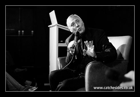 Peter Greenaway a man holding a microphone talking to audience