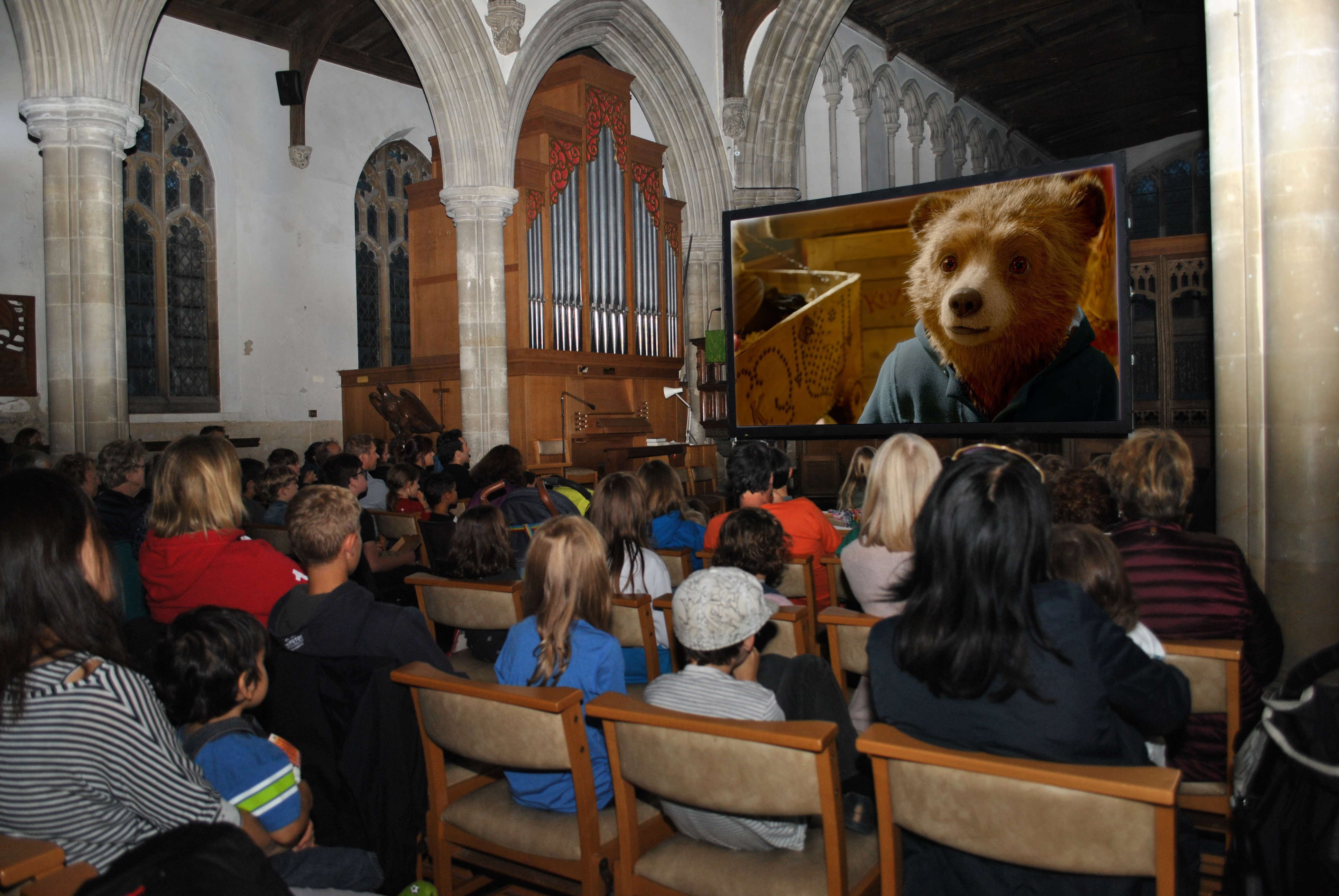 people watching paddington in a church