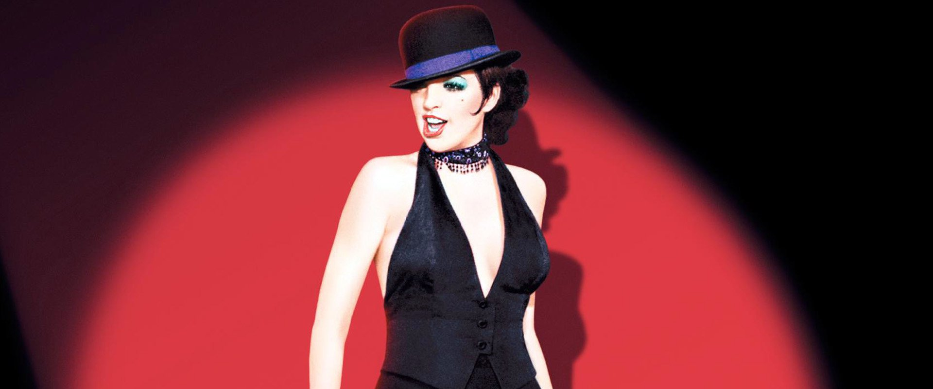 Liza Minelli singing dressed in show girl clothes