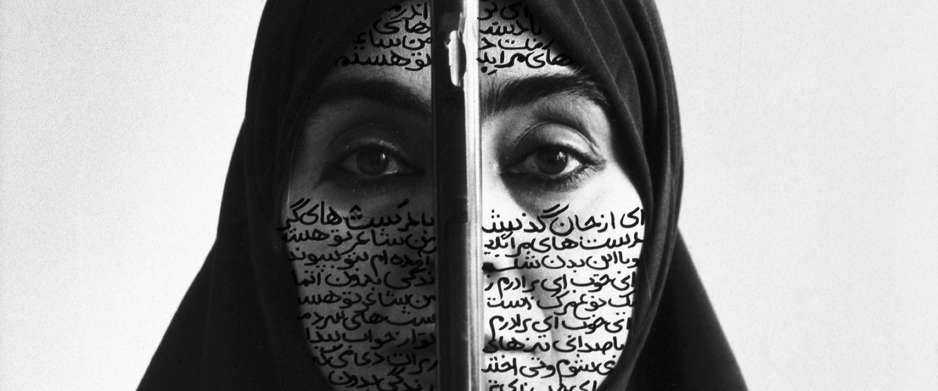 woman with writing on her face wearing black headscarf
