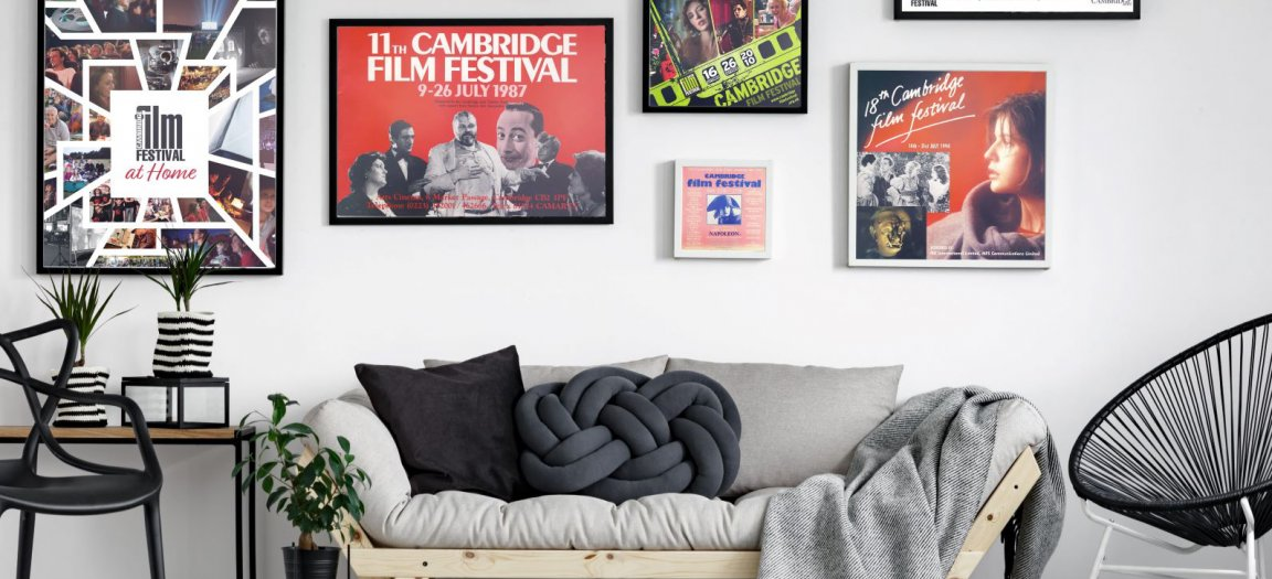 modern room with cambridge film festival posters on the wall