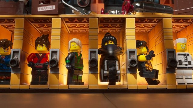 Six lego figures pose in a line