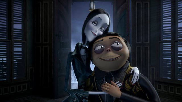 Morticia and Gomez Addams embrace happily