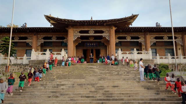 People stands around the entrance to a temple