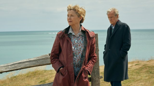 Annette Bening faces the opposite direction to Bill Nighy, who gazes at the floor guiltily