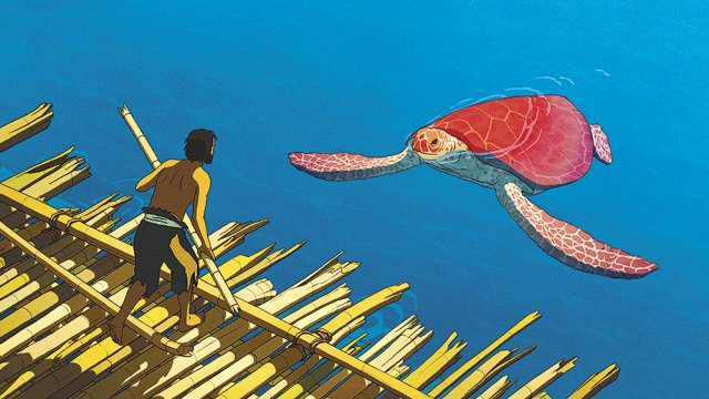 a man is looking at a big red turtle
