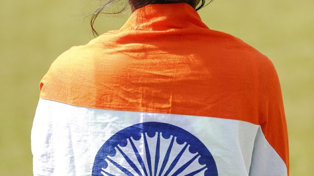 Girl wrapped in Indian flag