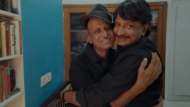 2 men with moustaches hugging