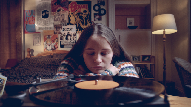 young girl eyes closed record player