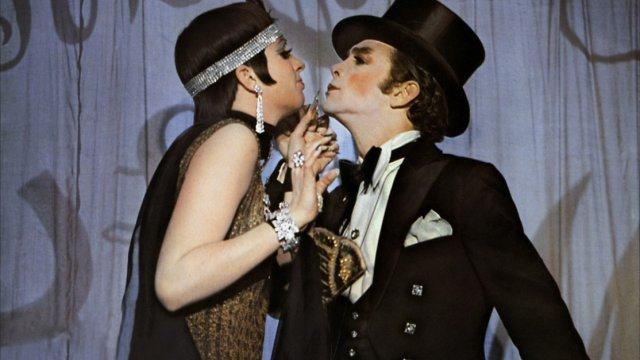 Liza Minelli and Joel Grey perform dressed as satirical rich people