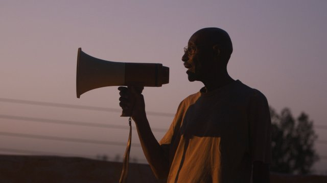 Man talks into a megaphone