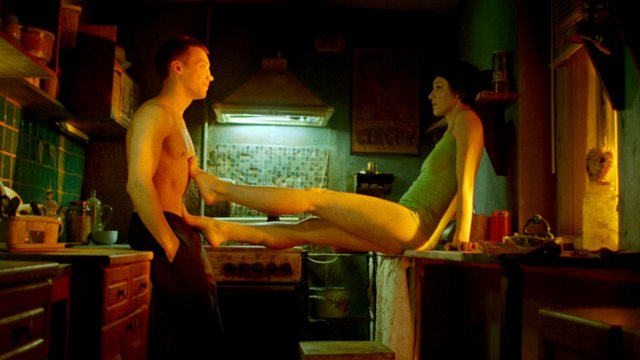 man and woman in kitchen, both semi-clothed