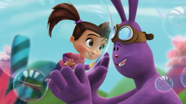 The purple rabbit is holding Kate in a small bubble