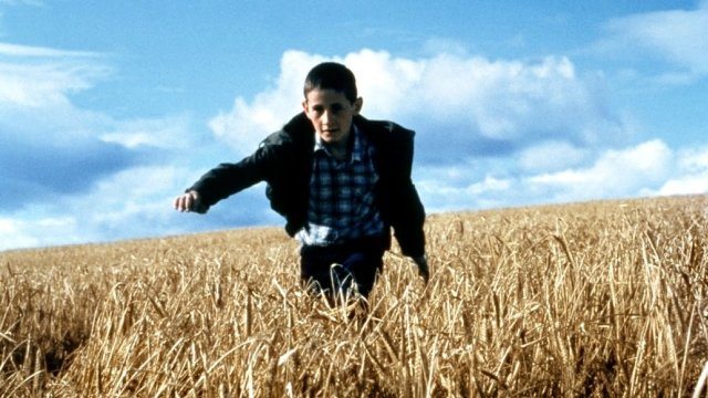 Boy running in a field