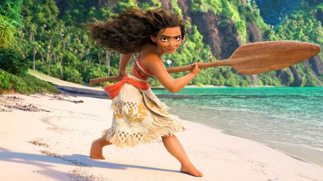 Moana on a beach with her paddle