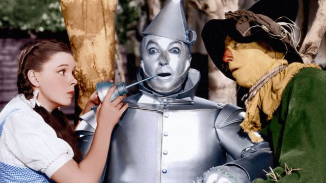 Dorothy applying oil to the tin man